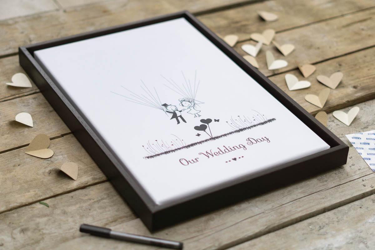 Idee zur Hochzeit Leinwand Gaestebuch mit Herzen